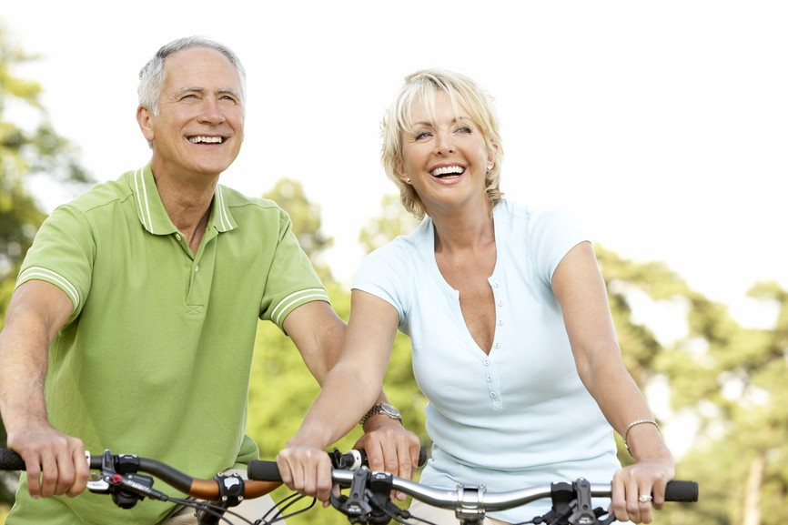Mature couple riding bikes greenville, nc movers